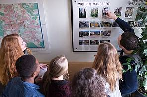 Students looking at the student hall information at Studierendenwerk
